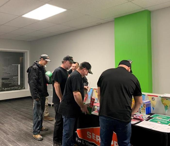 Left to right is Dylan Spigarelli, Brandon Mayer, Ron Chartrand, Kirk Pullen, Steve Wilson and Mckenzie Price, packing boxes